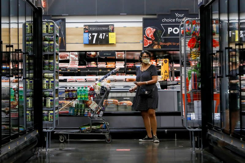 FILE PHOTO: FILE PHOTO: A shopper is seen wearing a mask while shopping at a Walmart store in Bradford, Pennsylvania
