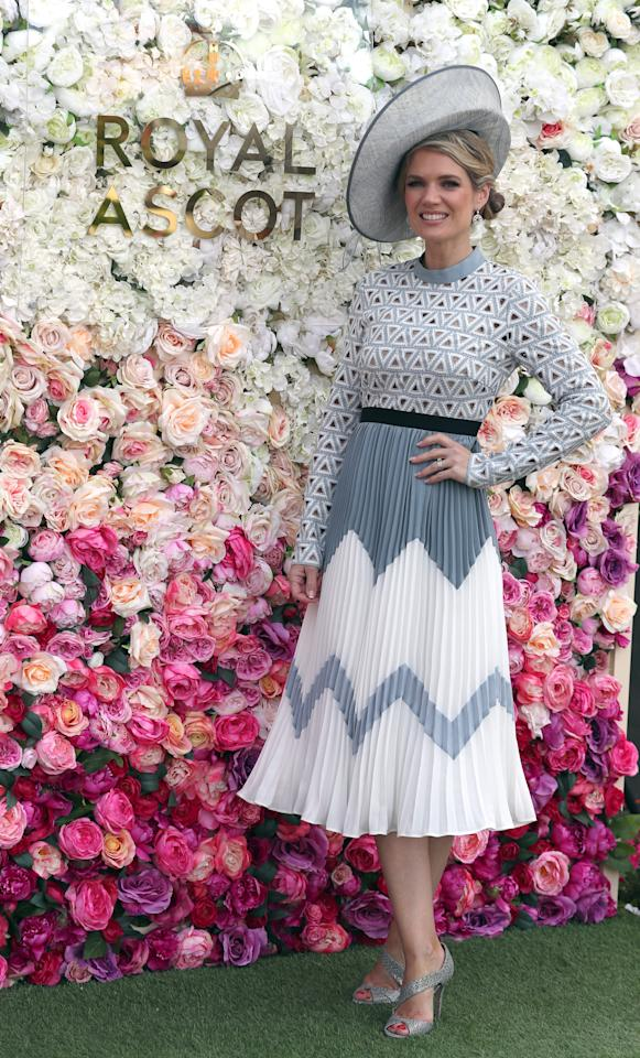 <p>Wearing a Self Portrait dress and a hat by Cara Meehan London, the tv presenter opted for a fairly low-key look on Ladies Day 2018. <em>[Photo: Getty]</em> </p>