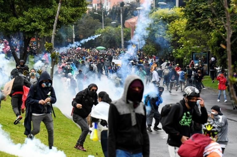 Demonstrators clash with riot outside Colombian President Ivan Duque's house in Bogota on May 1, 2021