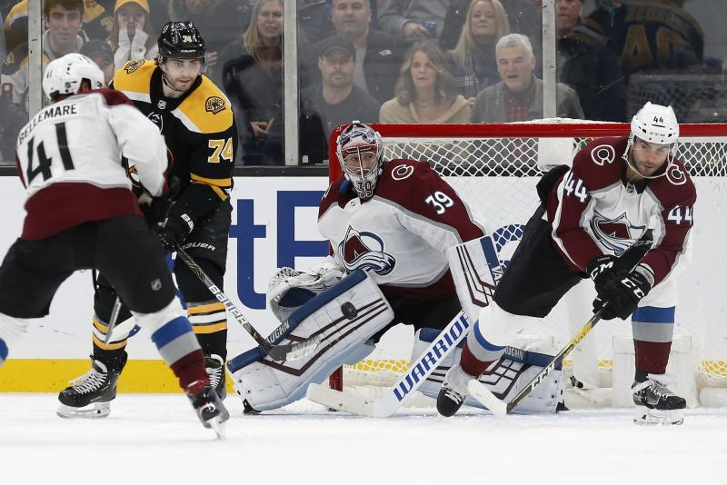 Boston Bruins' Jake DeBrusk (74) looks for a shot on Colorado Avalanche's Pavel Francouz (39) during the third period of an NHL hockey game in Boston, Saturday, Dec. 7, 2019. (AP Photo/Michael Dwyer)