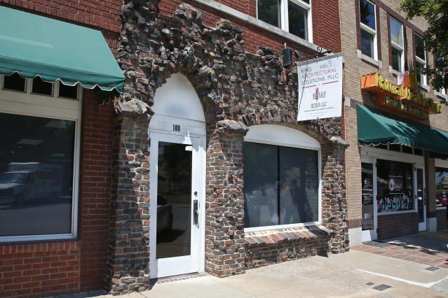 Burned bricks on a modern storefront are one of the few surviving reminders of the more than 30-block historic black district in Tulsa, Okla., Monday, June 15, 2020. (AP Photo/Sue Ogrocki)