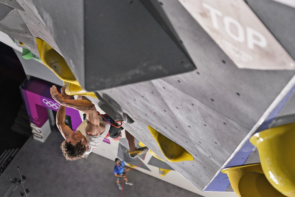 Adam Ondra, of the Czech Republic, participates during the lead qualification portion of the men's sport climbing competition at the 2020 Summer Olympics, Tuesday, Aug. 3, 2021, in Tokyo, Japan. (AP Photo/Jeff Roberson, POOL)