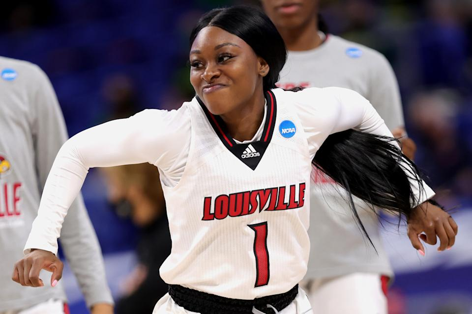 SAN ANTONIO, TEXAS - MARCH 28: Dana Evans #1 of the Louisville Cardinals enters the game against the Oregon Ducks in the Sweet Sixteen round of the NCAA Women's Basketball Tournament at the Alamodome on March 28, 2021 in San Antonio, Texas. (Photo by Carmen Mandato/Getty Images)