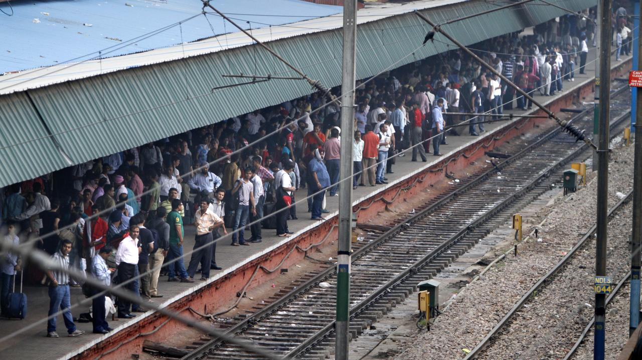 Stranded passengers wait for their trains at the New Delhi railway station in New Delhi, India, Monday, July 30, 2012. A major power outage has struck northern India, plunging cities into darkness and stranding hundreds of thousands of commuters. Trains across eight northern Indian states and metro services in New Delhi were affected by the outage that struck at about 2:30 a.m. local time. (AP Photo/Rajesh Kumar Singh)