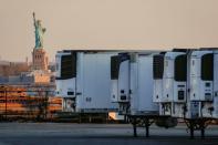 FILE PHOTO: Refrigerated tractor trailers used to store bodies of deceased people are seen at a temporary morgue in New York City