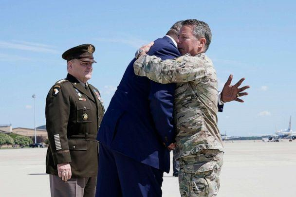 PHOTO: Secretary of Defense Lloyd Austin, center, greets Gen. Scott Miller, the former top U.S. commander in Afghanistan, as Joint Chiefs Chairman Gen. Mark Milley stands at left, upon Miller's return, July 14, 2021, at Andrews Air Force Base, Md. (Alex Brandon/Pool via AP)