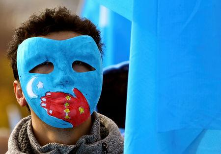 A man takes part in a demonstration against China during its Universal Periodic Review by the Human Rights Council in front of the United Nations Office in Geneva, Switzerland, November 6, 2018. REUTERS/Denis Balibouse