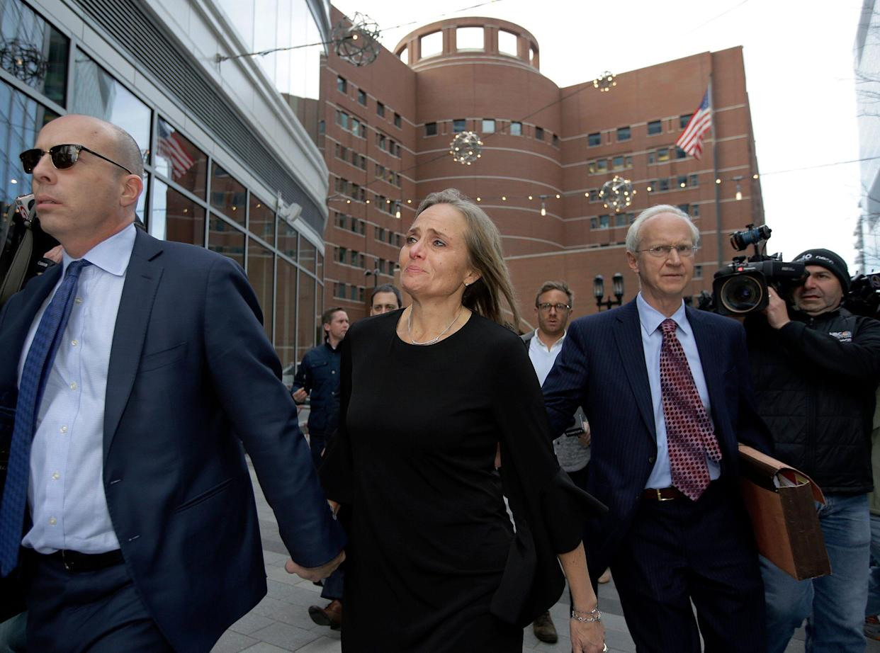 District Court Judge Shelley Richmond Joseph, center, departs federal court in Boston after facing obstruction of justice charges. (Photo: Steven Senne/AP)