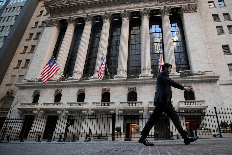 A man walks outside the New York Stock Exchange (NYSE) in New York, U.S., November 24, 2020. REUTERS/Brendan McDermid