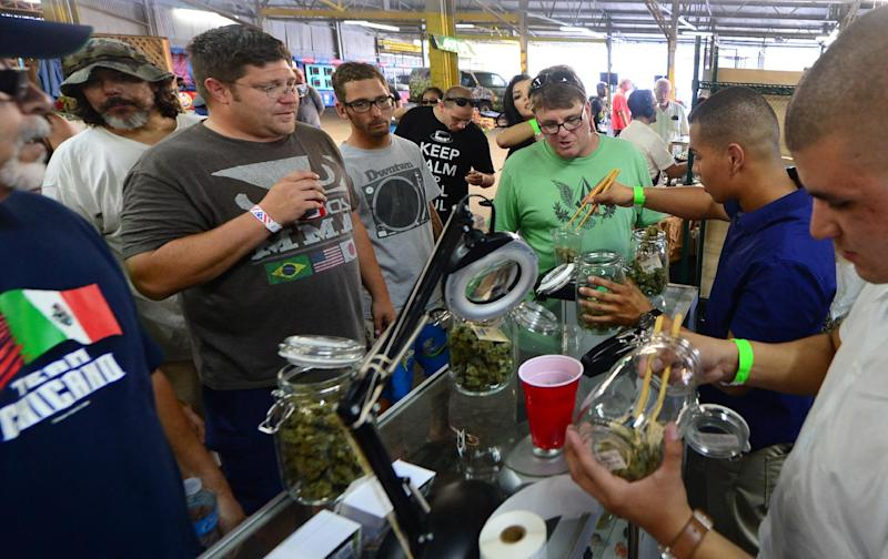 Marijuana is weighed at Los Angeles, California's first-ever cannabis farmer's market at the West Coast Collective medical marijuana dispensary on July 4, 2014 (AFP Photo/Frederic J. Brown)