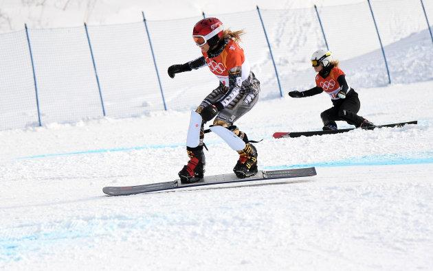 Ester Ledecka of the Czech Republic, front, races against Selina Jorg of Germany in the snowboard parallel giant slalom.