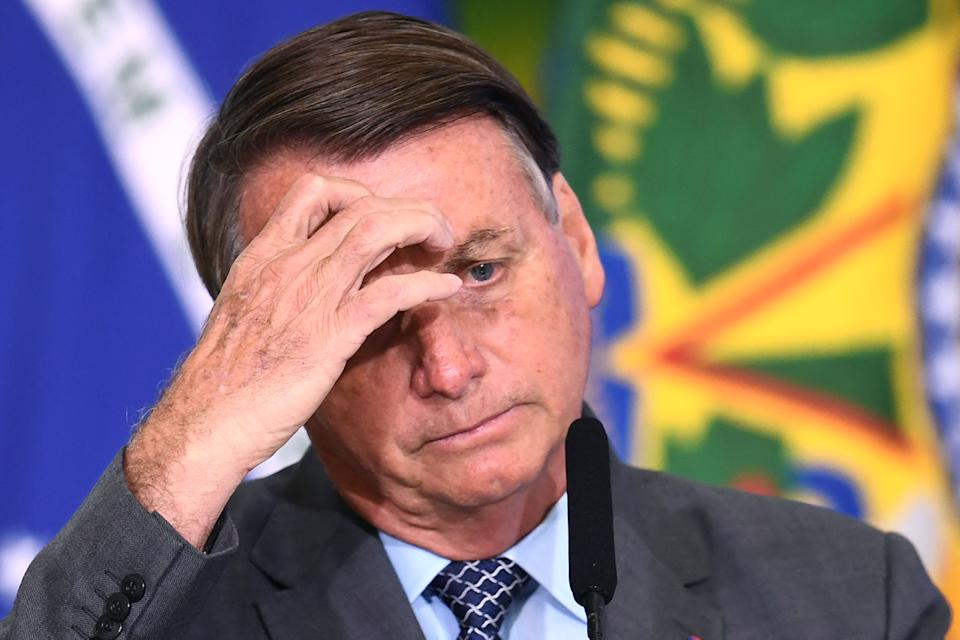 Brazilian President Jair Bolsonaro gestures during the launch of the Gigantes do Asfalto Program, which aims to reduce bureaucracy for cargo trucking, at Planalto Palace in Brasilia, on May 18, 2021. (Photo by EVARISTO SA / AFP) (Photo by EVARISTO SA/AFP via Getty Images)