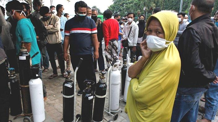 West Java residents with oxygen canisters