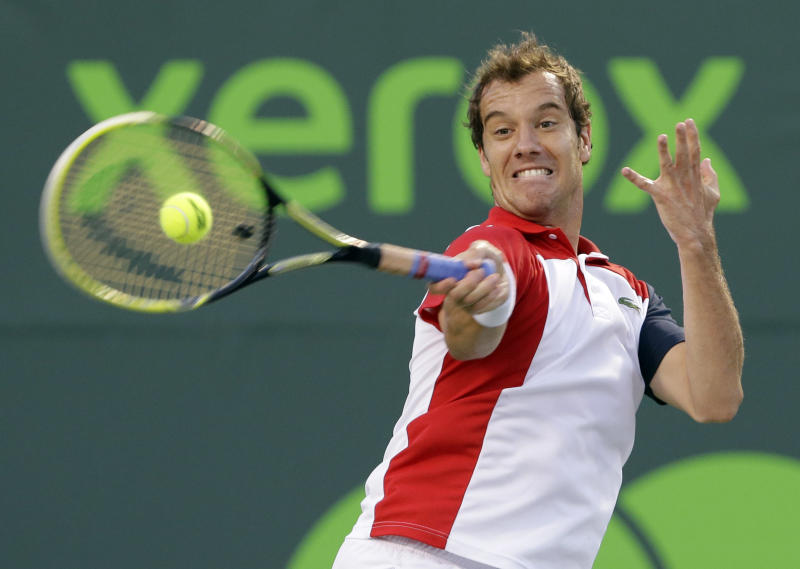 Richard Gasquet, of France, returns a shot from Andy Murray, of Great Britain, during a semifinal match at the the Sony Open tennis tournament on Friday, March 29, 2013, in Key Biscayne, Fla. (AP Photo/Wilfredo Lee)