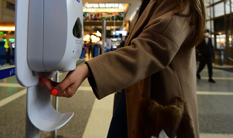 "A woman uses hand sanitizer at Los Angeles International Airport on March 12, 2020 one day before a US flight travel ban hits 26 European countries amid ongoing precautions over the Coronavirus. - US President Donald Trump announced a shock 30-day ban on travel from mainland Europe over the coronavirus pandemic that has sparked unprecedented lockdowns, widespread panic and another financial market meltdown Thursday.The announcement came as China, where the outbreak that first emerged in December, showed a dramatic drop in new cases and claimed ""the peak"" of the epidemic had passed. (Photo by Frederic J. BROWN / AFP) (Photo by FREDERIC J. BROWN/AFP via Getty Images)"