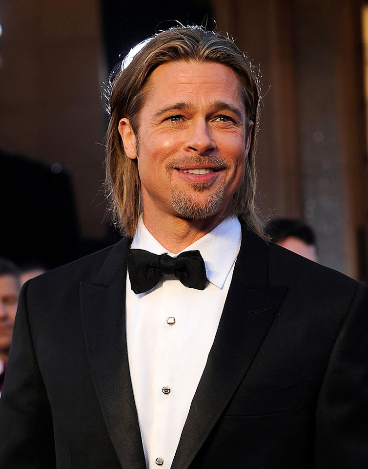 Brad Pitt arrives at the 84th Annual Academy Awards in Hollywood, CA.