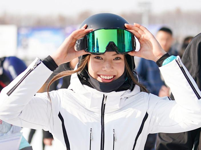 Skiier Eileen Gu poses at press conference in Beijing, China.