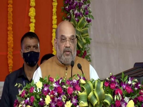 Union Minister Amit Shah addressing at the inauguration of the City Civic Centre at South Bopal in Gujarat's Ahmedabad on Sunday. [Photo/ANI]