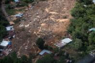 A general view shows an area hit by a mudslide, caused by heavy rains brought by Storm Eta, as the search for victims continue in the buried village of Queja