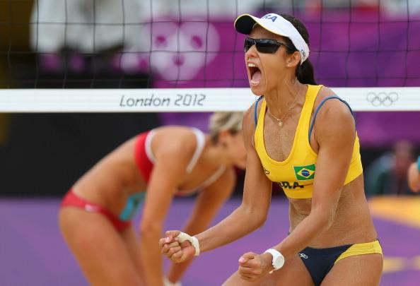 LONDON, ENGLAND - JULY 31:  Talita Rocha of Brazil  celebrates during the Women's Beach Volleyball Preliminary match between Brazil and Germany on Day 4 at Horse Guards Parade on July 31, 2012 in London, England.  (Photo by Ryan Pierse/Getty Images)