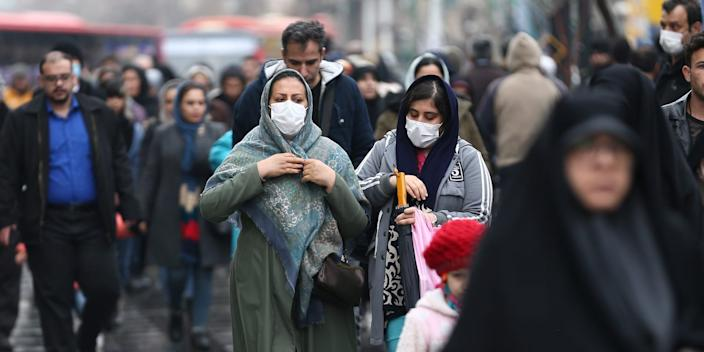 Iranian women wear protective masks to prevent contracting the coronavirus at the Grand Bazaar in Tehran on February 20, 2020.