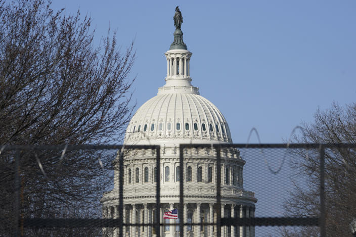 """Security fencing surrounds Capitol Hill in Washington, Thursday, March 4, 2021. Capitol Police say they have uncovered intelligence of a """"possible plot"""" by a militia group to breach the U.S. Capitol on Thursday, nearly two months after a mob of supporters of then-President Donald Trump stormed the iconic building to try to stop Congress from certifying now-President Joe Biden's victory. (AP Photo/Susan Walsh)"""
