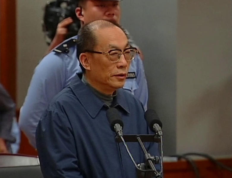 In this image made from China Central Television video, former Chinese Railways Minister Liu Zhijun speaks at a courtroom in Beijing No. 2 Intermediate People's Court in Beijing Sunday, June 9, 2013. Liu admitted his guilt and sought leniency Sunday at his trial on corruption charges, one of the country's highest-level graft cases in years. Liu, 60, who oversaw Railways Ministry's high-profile bullet train development, has been accused of taking massive bribes and steering lucrative projects to associates. The case is seen as an indicator of how top-level officials might fare in an anti-corruption campaign that Chinese leader Xi Jinping has vowed will target both high and low officials. (AP Photo/CCTV via AP Video) CHINA OUT, TV OUT