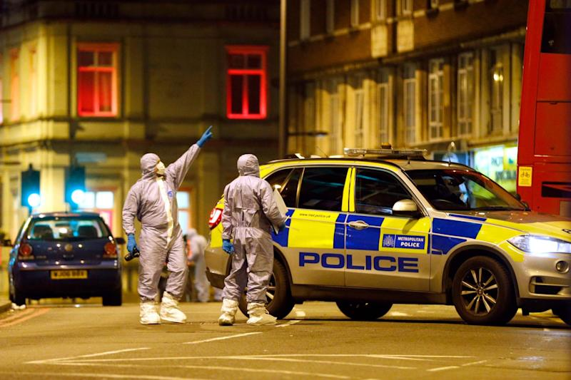 Forensic officers examine the scene where a man was shot and killed by armed police (Getty Images)