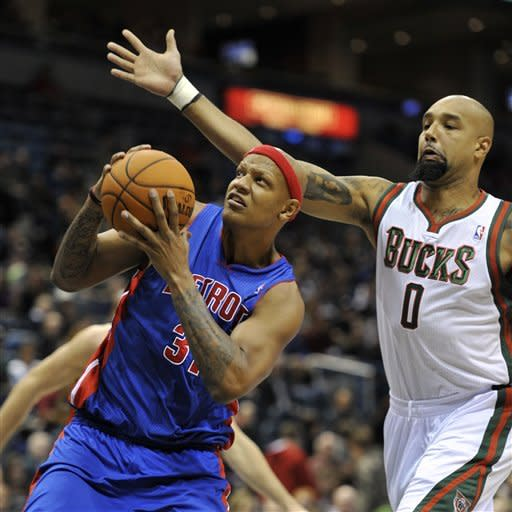 Detroit Pistons' Charlie Villanueva left, drives to the basket against Milwaukee Bucks' Drew Gooden (0) during the first half of an NBA basketball game on Saturday, Oct. 13, 2012, in Milwaukee. (AP Photo/Jim Prisching)