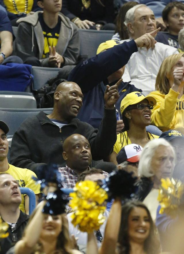 Glenn Robinson, former NBA player and father of Michigan forward Glenn Robinson III, watches during the second half of a second round NCAA college basketball tournament game between the Michigan and the Wofford Thursday, March 20, 2014, in Milwaukee. (AP Photo/Jeffrey Phelps)