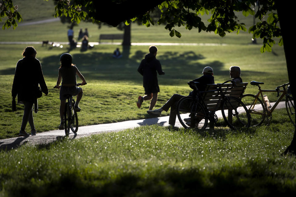 People relax and exercise in Primrose Hill park in central London, as the UK continues in lockdown to help curb the spread of the coronavirus.
