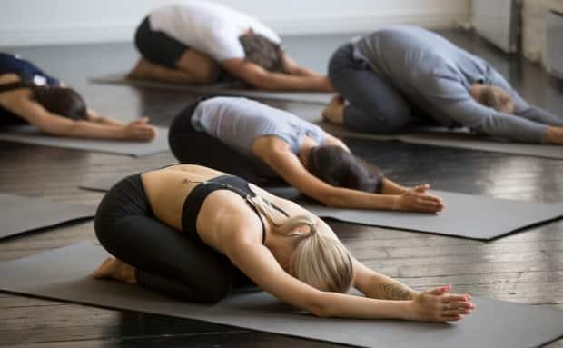 A Saskatoon lawyer believes a Regina yoga studio isn't breaking any rules by asking customers for proof they've been vaccinated. (Shutterstock - image credit)