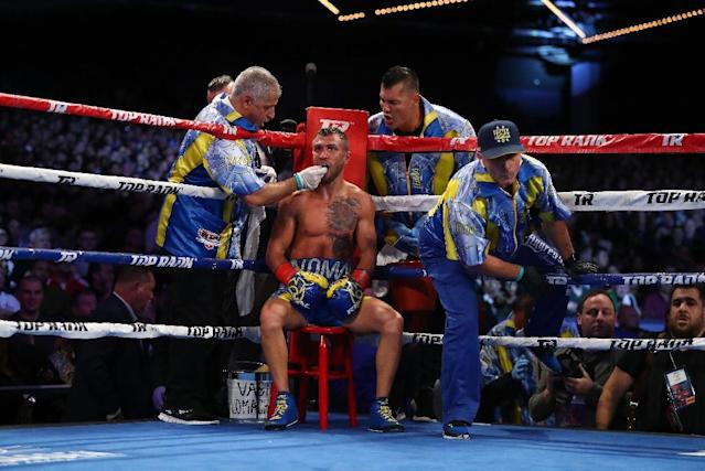 Vasiliy Lomachenko set a record in claiming a world title in a third weight division in just his 12th professional fight (AFP Photo/AL BELLO)