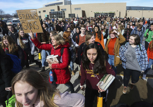 <p>Students at Mayo High School stage a walkout against gun violence for 17 minutes during the school day Wednesday, Feb. 21, 2018, in Rochester, Minn. The 17 minutes were in memory of the 17 victims in the Marjory Stoneman Douglas High School shooting in Parkland, Fla., on Feb. 14. (Photo: Andrew Link/The Rochester Post-Bulletin via AP) </p>