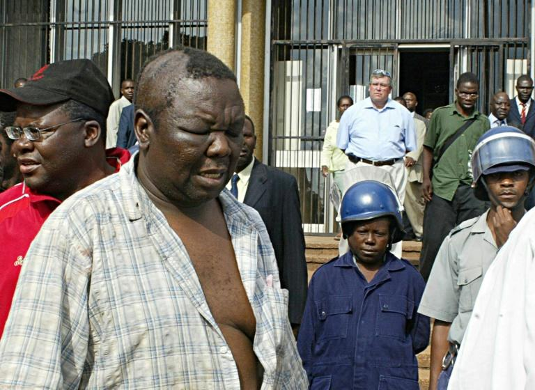 Morgan Tsvangirai leaving a court in Harare for hospital treatment after police violently cracked down on an opposition rally