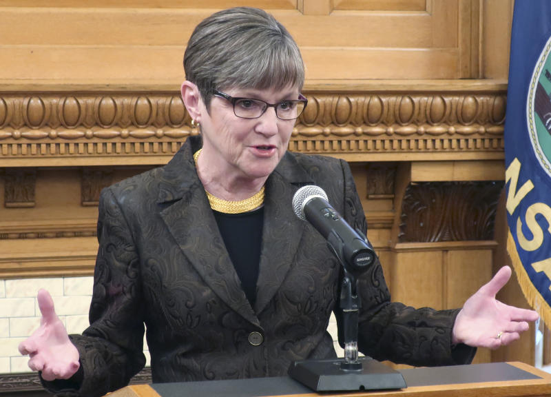 "Kansas Gov. Laura Kelly answers questions from reporters as she announces her veto of a Republican tax relief bill during a news conference, Monday, March 25, 2019, at the Statehouse in Topeka, Kansas. The Democratic governor said the tax bill would have created a ""self-inflicted budget crisis."" (AP Photo/John Hanna)"