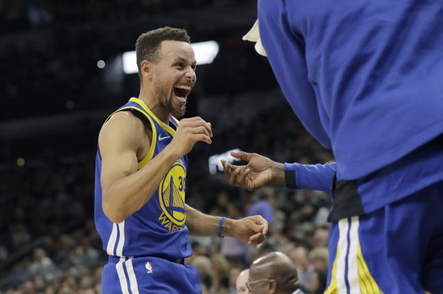 """<a class=""""link rapid-noclick-resp"""" href=""""/nba/players/4612/"""" data-ylk=""""slk:Stephen Curry"""">Stephen Curry</a> can't contain his enthusiasm at finally being famous enough to appear in a tax proposal. (AP)"""