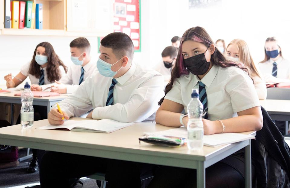 Pupils wear face masks at a school in Scotland (PA)