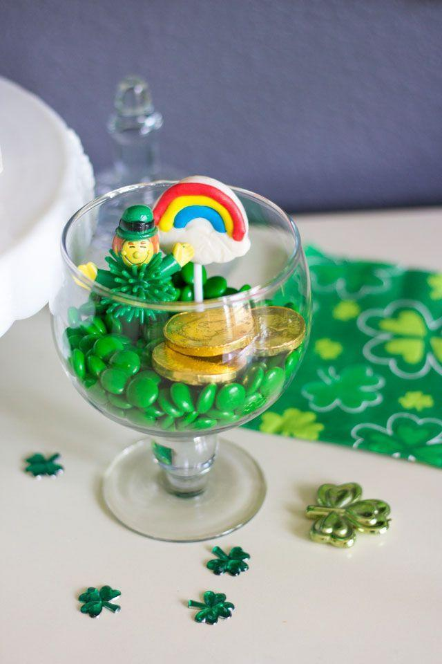 """<p>Who knew that some candy and a couple trinkets would make for the cutest holiday terrarium ever? Have your kid fill their own glass jar with gold coins, rainbow lollipops and plastic shamrocks for a super-easy DIY project.</p><p><a class=""""link rapid-noclick-resp"""" href=""""https://www.amazon.com/Palais-Glassware-Clear-Glass-Apothecary/dp/B01BCNO9K0/?tag=syn-yahoo-20&ascsubtag=%5Bartid%7C10055.g.1019%5Bsrc%7Cyahoo-us"""" rel=""""nofollow noopener"""" target=""""_blank"""" data-ylk=""""slk:SHOP GLASS JARS"""">SHOP GLASS JARS</a></p><p><em><a href=""""https://designimprovised.com/2017/03/diy-potted-paper-shamrocks.html"""" rel=""""nofollow noopener"""" target=""""_blank"""" data-ylk=""""slk:Get the tutorial at Design Improvised »"""" class=""""link rapid-noclick-resp"""">Get the tutorial at Design Improvised »</a></em></p>"""
