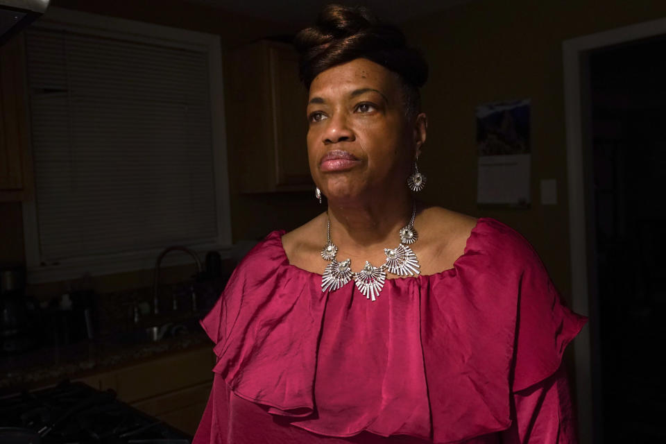 Karla Jefferies stands in her kitchen in Detroit, Friday, March 5, 2021. Jefferies, 64, a retired state worker in Detroit, Michigan, tested positive for COVID-19 in March 2020 and has been bothered by puzzling symptoms ever since. First it was fatigue, fever, and no taste or smell. Then came brain fog, insomnia, a nagging smell of something burning that only recently disappeared, and intermittent ringing in her ears. Now she can't hear out of her left ear. (AP Photo/Paul Sancya)