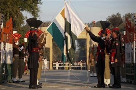 Pakistan Rangers (R) and Indian Border Security Force personnel take part in the daily flag lowering ceremony at their joint border post of Wagah near Lahore February 10, 2011. REUTERS/Mohsin Raza/Files