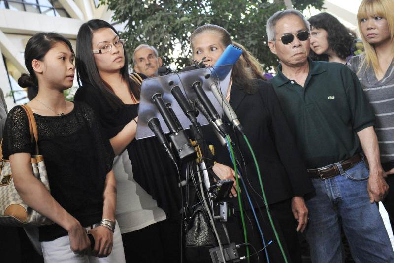 Souksavanh Phanthavong, left, the niece of Anousone Phanthavong, addresses the media as other family members gather after a jury found Amy Senser, the wife of former Minnesota Vikings NFL football star Joe Senser, guilty Thursday, May 3, 2012, in Minneapolis , on two felonies in a hit-and-run that killed Phanthavong last year. (AP Photo/Jim Mone)