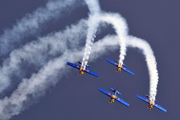 Members of The Flying Bulls aerobatics team from the Czech Republic fly in formation in their Zlin Z-50 aircraft during Aero India 2013 at the Yelahanka Air Force station in Bangalore on February 6, 2013. India, the world's leading importer of weaponry, opened one of Asia's biggest aviation trade shows Wednesday with Western suppliers eyeing lucrative deals and a Chinese delegation attending for the first time. AFP PHOTO/Manjunath KIRAN