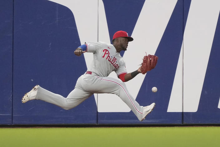 Philadelphia Phillies center fielder Odubel Herrera cannot make the catch on a triple by San Francisco Giants' LaMonte Wade Jr. during the fourth inning of a baseball game Friday, June 18, 2021, in San Francisco. (AP Photo/Tony Avelar)