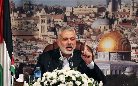 Ismail Haniyeh, prime minister of the Hamas Gaza government, gestures as he delivers a speech in Gaza City