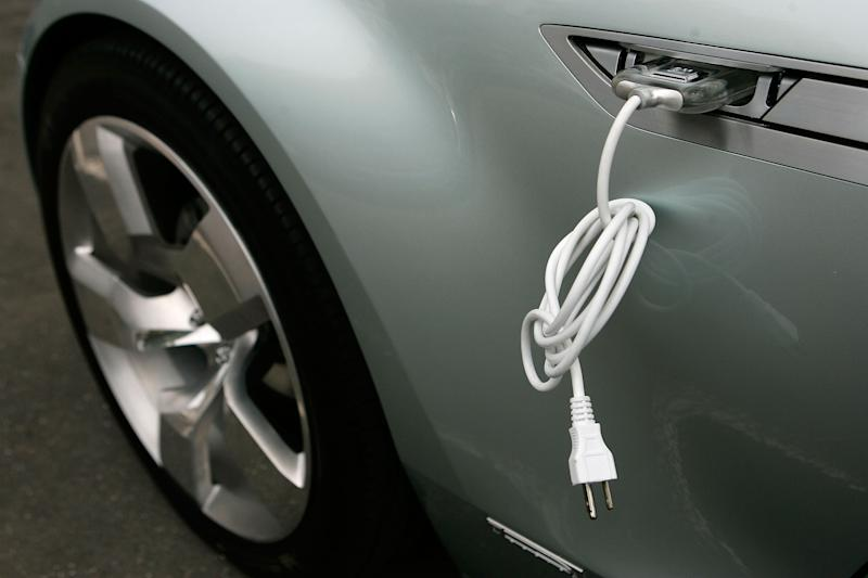 WASHINGTON - JULY 19: An electric cable is attached to the side of a Chevrolet Volt vehicle during a viewing on Capitol Hill July 19, 2007 in Washington, DC. The Volt is a plug-in electric vehicle which will run its first 40 miles without using any gasoline, and then the battery pack will be re-charged by a small internal combustion engine that runs on gas, diesel or ethanol when required. The vehicle is expected to be on the market by 2010. (Photo by Alex Wong/Getty Images)