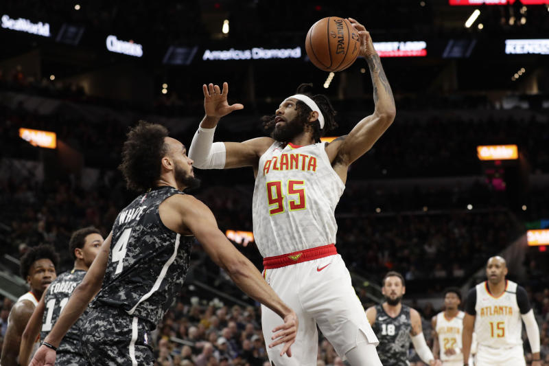 Atlanta Hawks guard DeAndre' Bembry (95) drives to the basket against San Antonio Spurs guard Derrick White (4) during the first half of an NBA basketball game in San Antonio, Friday, Jan. 17, 2020. (AP Photo/Eric Gay)