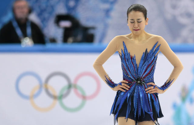 Mao Asada of Japan reacts after completing her routine in the women's free skate figure skating finals at the Iceberg Skating Palace during the 2014 Winter Olympics, Thursday, Feb. 20, 2014, in Sochi, Russia. (AP Photo/Ivan Sekretarev)