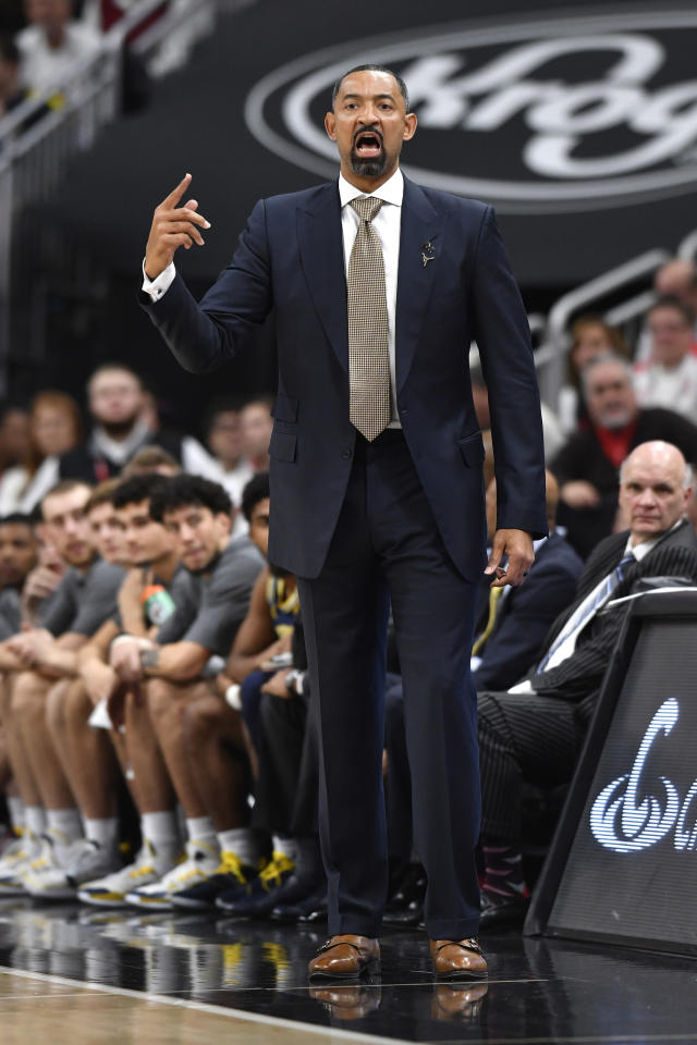 Michigan head coach Juwan Howard signals a play in to his team during the first half of an NCAA college basketball game in Louisville, Ky., Tuesday, Dec. 3, 2019. Louisville won 58-43. (AP Photo/Timothy D. Easley)