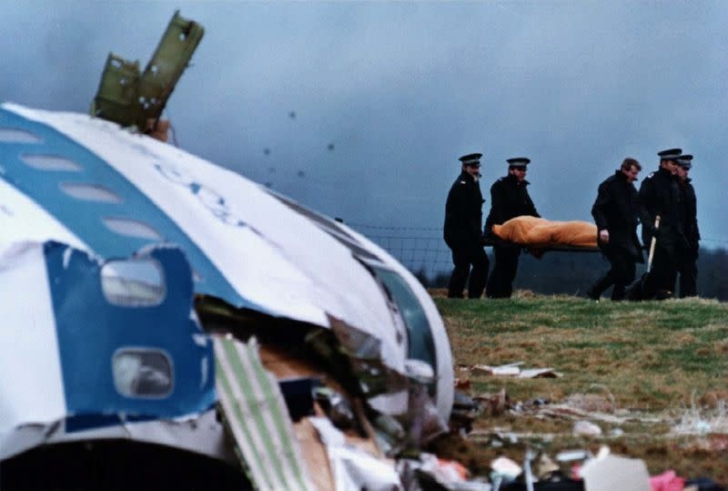 FILE PHOTO: FILE PHOTO SHOWS POLICE STRETCHERING VICTIM FROM LOCKERBIE AIR DISIASTER.